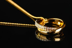 Gold ring pendant on a necklace
