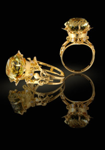 Gold rings with brilliants and gem on a black