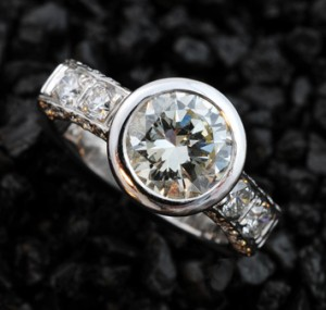 Diamond ring with a bezel setting