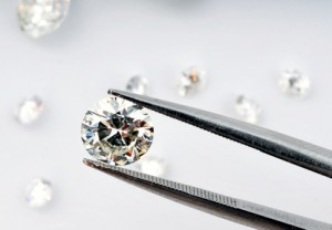 Black spots in diamonds are dots of carbon that hasn't crystallized.