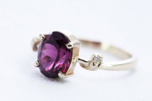 Ring with garnet in a prong setting